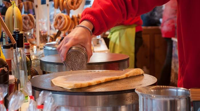 Sugar crêpes at a Christmas market stall in France