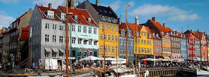 Copenhagen's Nyhavn waterfront is a beautiful place to visit, whatever the weather.