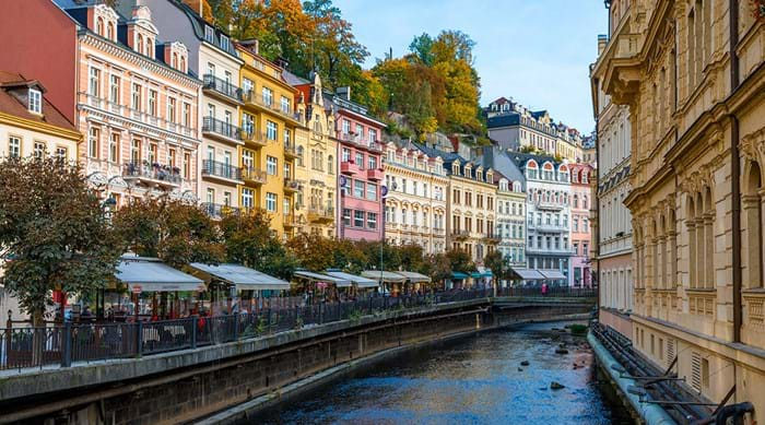 Take a refreshing stroll along the river that runs through the paintbox coloured town of Karlovy Vary