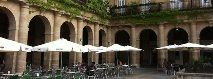 Enjoy a coffee at Bilbao's scenic New Square