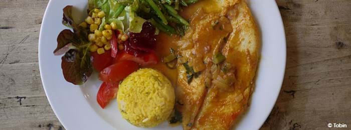 A Surinamese dish of white fish in yellow currya