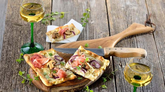 An Alsatian wine makes the perfect pairing with local dish tarte flambée.