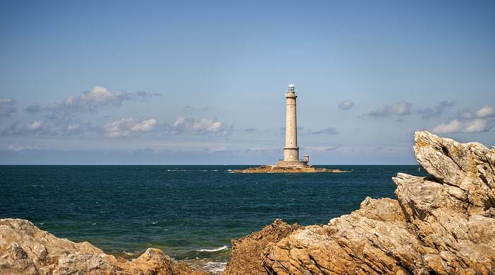 See the pretty lighthouse at Cap de la Hague.