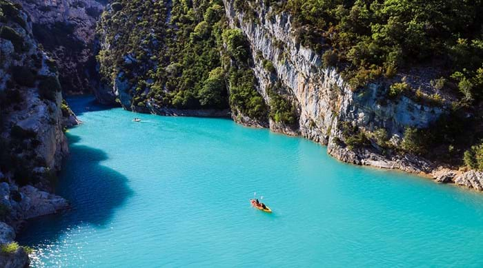 Kayak across the turquoise water of this serene calanque