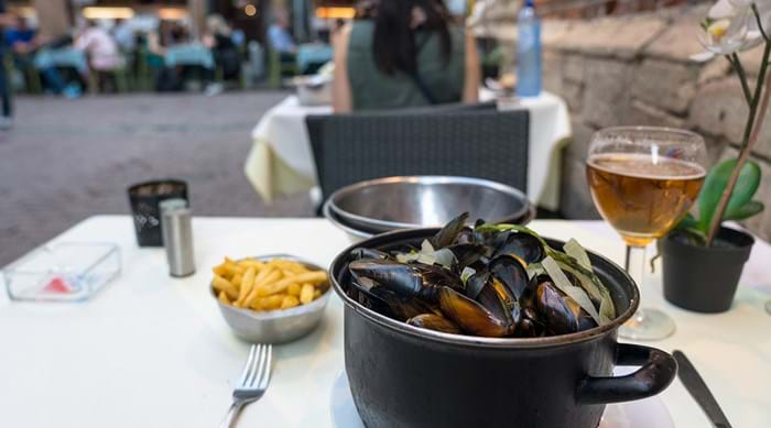 Mussels and chips are delicious and fun to eat