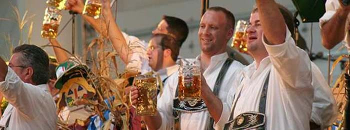 Revellers enjoying the festivities in the beer tents at Oktoberfest