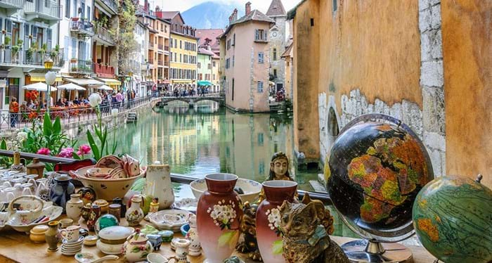 Explore the market stalls around the canals in Annecy
