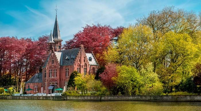 Go for a romantic stroll around Minnewaterpark in Bruges.