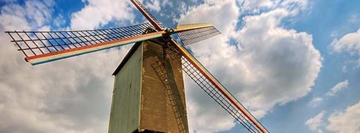 You can cycle to see the windmills just outside of Bruges when you stay at Campsite Memling